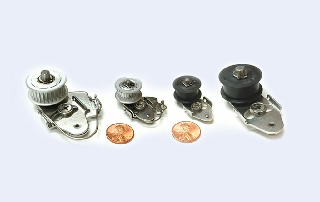 4 tensioners with pennies for size